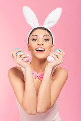 Portrait  attractive bunny woman with easter eggs