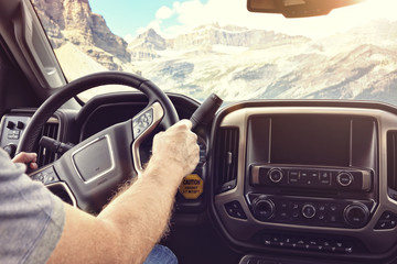 Driving a car truck or motorhome rv on a rural road through the mountains