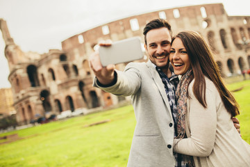 Couple taking selfie in Rome, Italy
