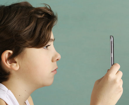 smartphone addicted school teen boy close up photo