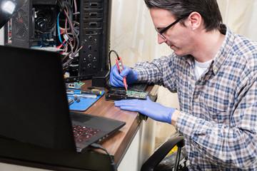technician working on the hard drive