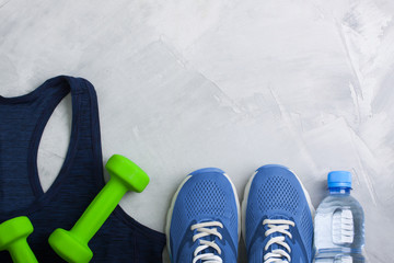 Flatlay sport composition with equipment outfit blue sneakers and t-shirt