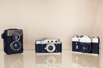 Three ancient cameras of different years