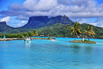 View from Bora Bora airport. Beautiful palms, mountains and blue sea. French Polynesia, South Pacific Ocean. HDR (High dynamic range) picture.