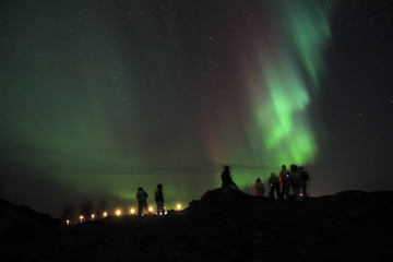 People braving the cold to watch the Northern lights. Tromso, Norway.