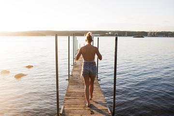 Sweden, Vastra Gotaland, Gothenburg, Woman walking on pier