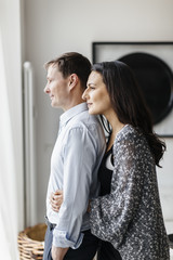 Germany, Couple hugging in living room