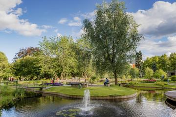 Sweden, Uppland, Uppsala, Stadsparken, Pond and fountain in park