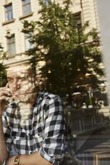 Sweden, Man sitting, talking on phone