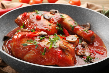 Frying pan with chicken cacciatore, closeup
