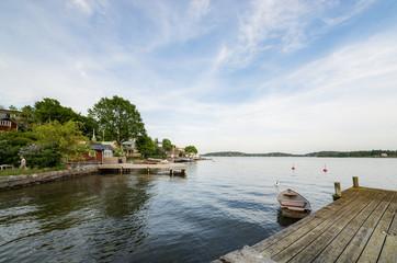 Sweden, Stockholm Archipelago, Uppland, Vaxholm, Rowboat moored to pier