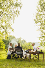 Sweden, Sodermanland, Jarna, Family with baby girl (6-11 months) having picnic