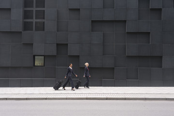 Norway, Oslo, Stewardesses walking with suitcases