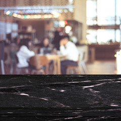 Empty black marble table over blur cafe background, product and food display montage