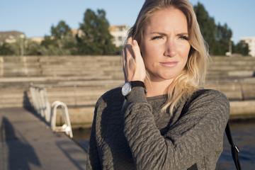 Sweden, Skane, Malmo, Portrait of young blonde woman on pier