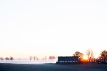 Sweden, Skane, Skurup, Soderslatt, Landscape with cottage during winter