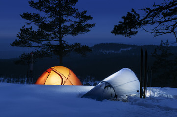 Sweden, Vastmanland, Kindla nature reserve, Two tents on snow