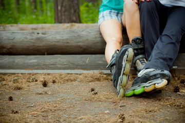 couple sitting in a Park in roller skates