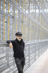 Sweden, Man standing in front of construction