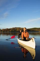 Sweden, Skane, Raslangen, Two men paddling boat on lake