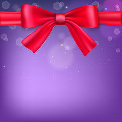 Abstract blurred background with bokeh effect and glowing colored spots. Tied with a big red bow