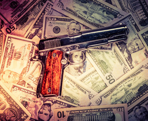 Hand gun and cash