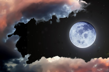 Dramatic of full moon sky and clouds.Image of Full Moon furnished by NASA.