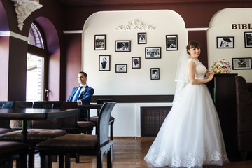 bride and groom in restaurant near the table