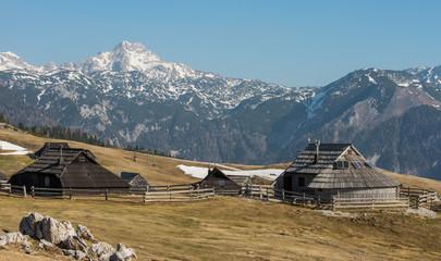 scenic old traditional wooden shepherd cottage on high alpine pasture Velika Planina near Kamnik, Slovenia