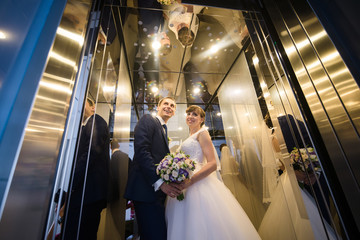 Wedding couple in the lift
