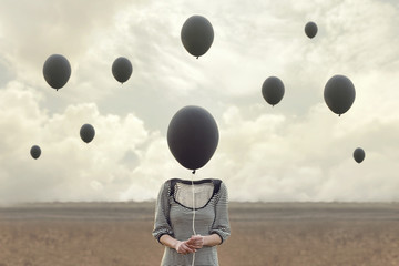 surreal image of woman and blacks balloons flying Wall mural