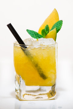 Exotic cocktail with mango and mint on a light background