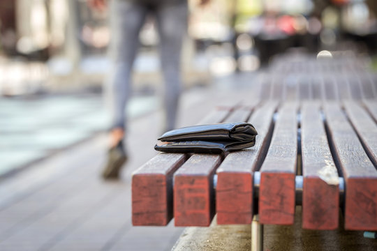 man lost his wallet on a bench on street