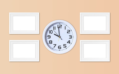 Alarm clock and four blank photo frames mock ups, office style interior decoration