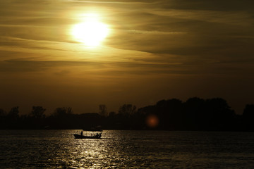 Fishing boat silhouette at dawn