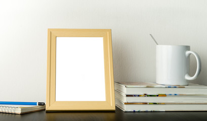 Blank photo frame for picture mock up on working table