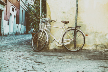 Classic bike leaning against the wall.Photo processing for the style of instagram.Italy