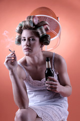 housewife with smoking cigarette and beer