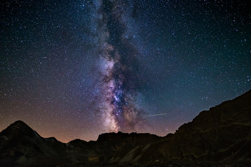 The outstanding beauty and clarity of the Milky Way and the starry sky captured from high altitude on the italian Alps.