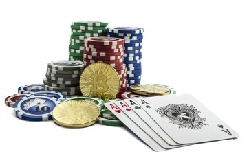 Bitcoin coins with poker cards and chips