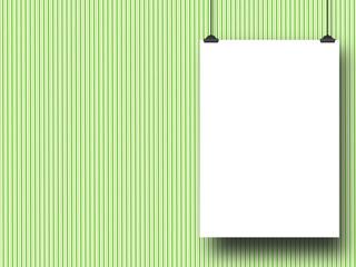 Blank frame against green striped wallpaper