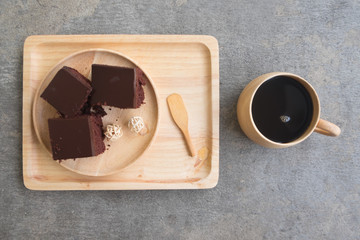 Delicious chocolate cake served with hot coffee