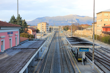 Aluminium Prints Train Station The medieval village of Narni seen from the train station and the industrial distracted in the valley, Umbria, Italy