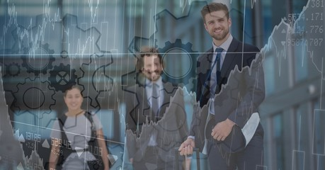 Three business people with chart and gear graphic overlay
