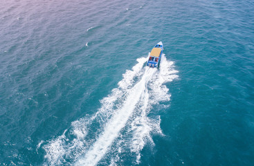 speed boat running fast in the sea coast in aerial view