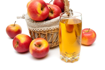Ripe apples and a glass with apple juice on a white background