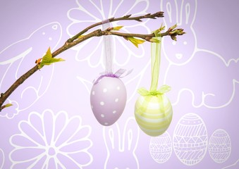Easter eggs hanging on branch in front of pattern
