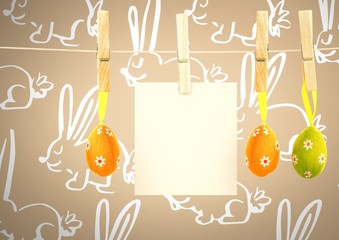 Easter Eggs on pegs with note in front of pattern
