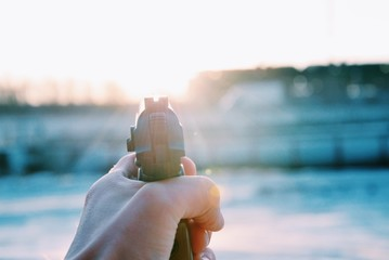 Cropped Image Of Person Holding Gun