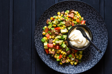 Salad with avocado tomato corn mushrooms and mayonnaise